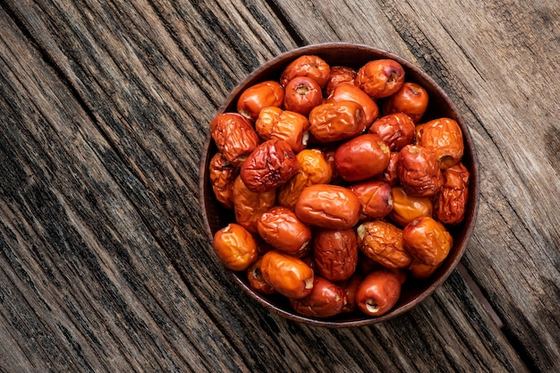 Dried jujube fruits on an old wood .top view,flat lay.