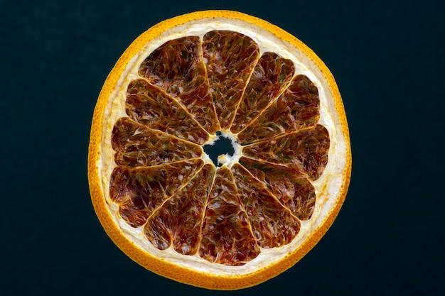 Dried lemon slice on a dark background