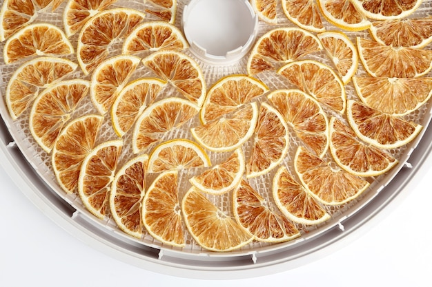 The dried lemon slices on the tray dryers