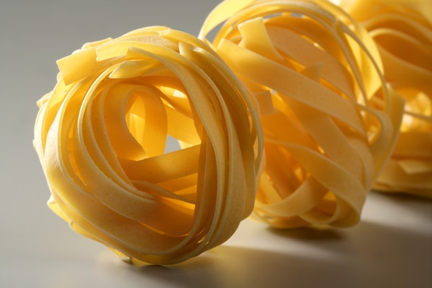 Dried macro noodles yellow pasta, studio shot