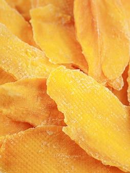Dried mango slices. close-up. macro. texture.