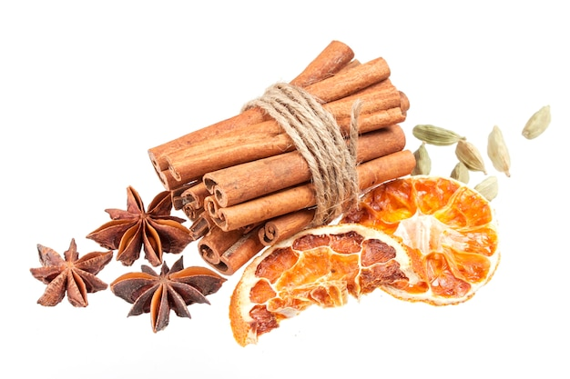 Dried orange, anise stars and cinnamon sticks isolated on white