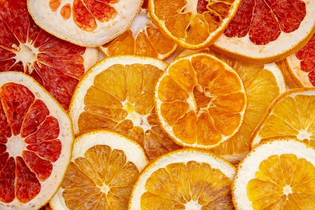 Dried orange grapefruit and lemon slices background