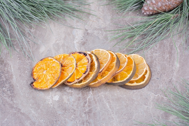 Dried orange slices in a stock on marble surface