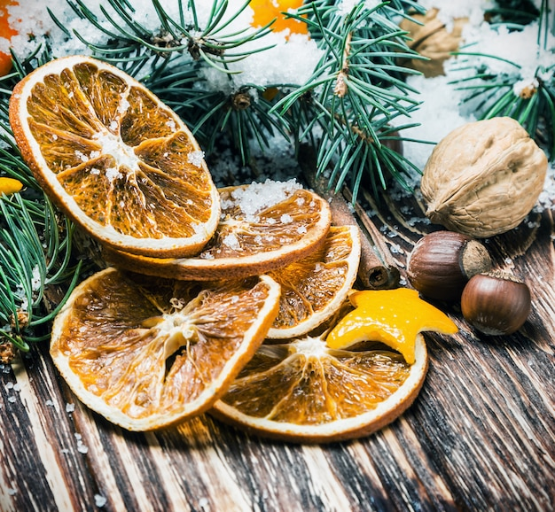 Dried oranges with nuts and fir branches