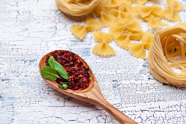 Dried pasta on wooden