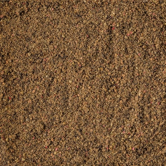 Dried pepper spice background texture, top view