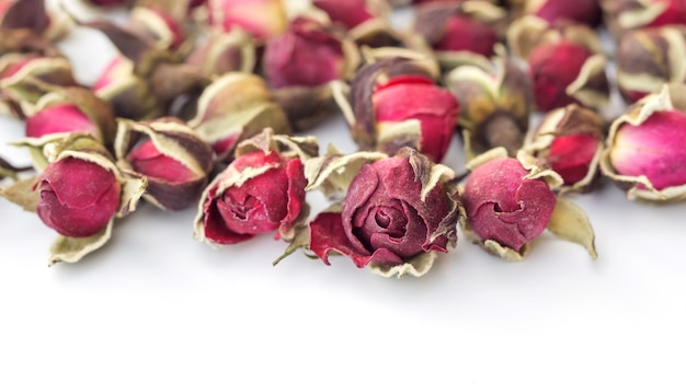 Dried pink rose on a white background.