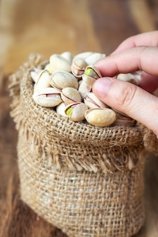 Dried pistachios in small sack. grain for healthy. good fat.