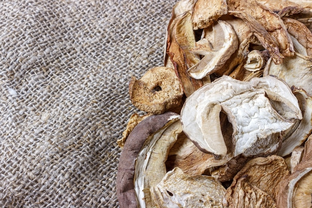 Dried porcini mushrooms on sackcloth.