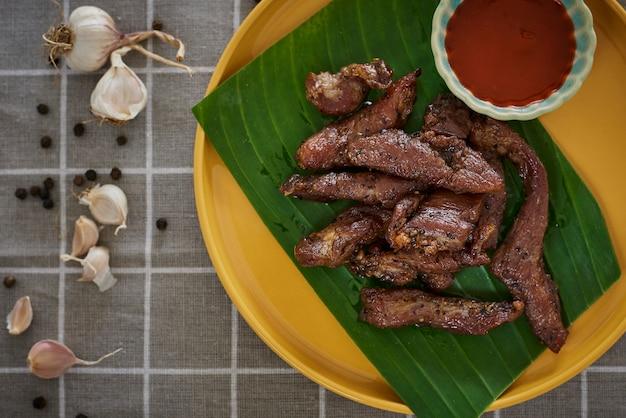 Dried pork, thai-esan food. pork with seasoning herb garlic