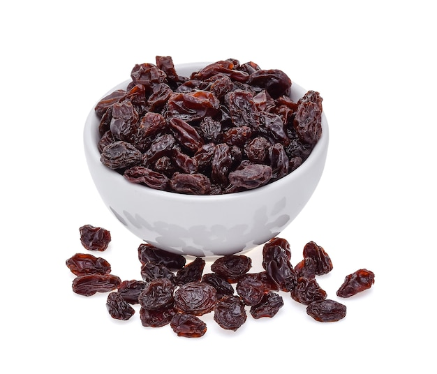 Dried raisins in bowl  isolated on white background