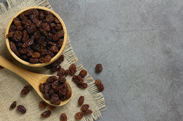 Dried raisins in bowl on table