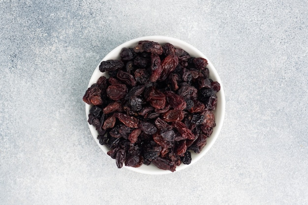 Dried raisins from dark grapes in a plate