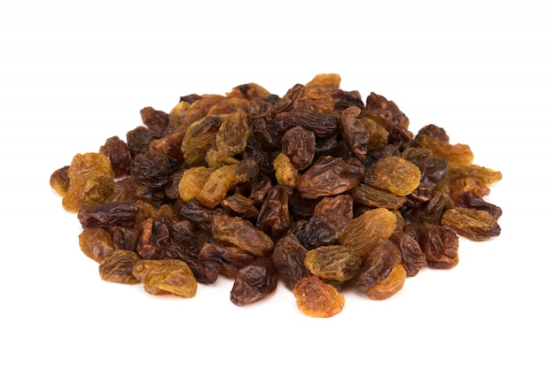 Dried raisins isolated on white.