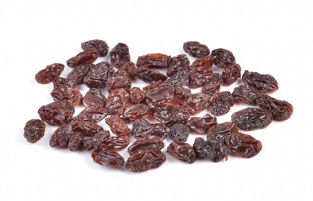 Dried raisins on a white wall