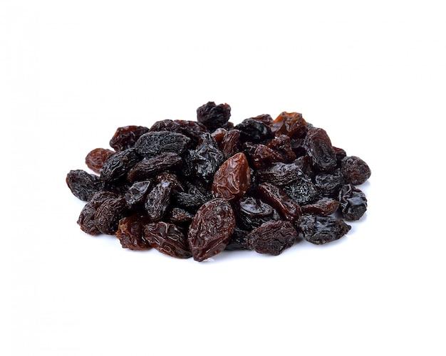 Dried raisins on white
