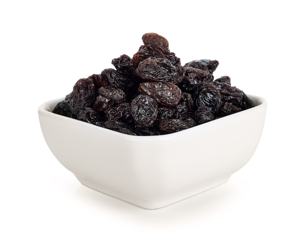 Dried raisins on white.