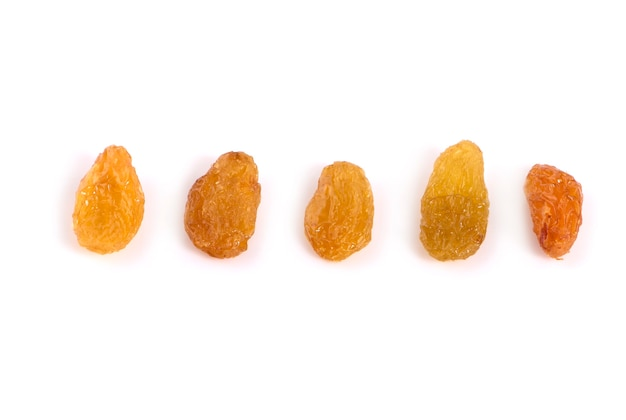Dried raisins yellow raisins on a white surface Premium Photo