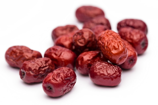 Dried red date or chinese jujube. traditional herbal medicine spill on mat.