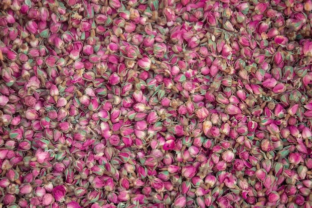 Dried rosebuds background texture.