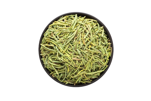 Dried rosemary in clay bowl isolated on white background. seasoning or spice top view