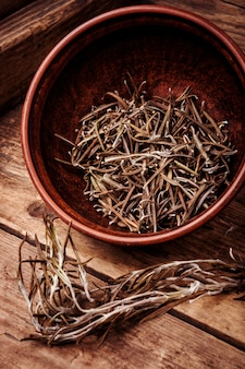 Dried rosemary on vintage background