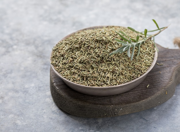 Dried rosemary  on white surface