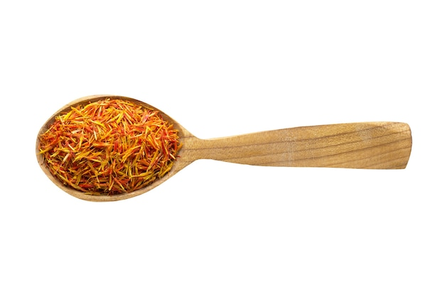 Dried saffron  for adding to food. spice in wooden spoon isolated on white. seasoning of delicious meal.
