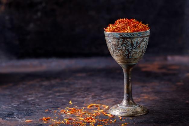Dried saffron spice a glass of metal oriental flavor
