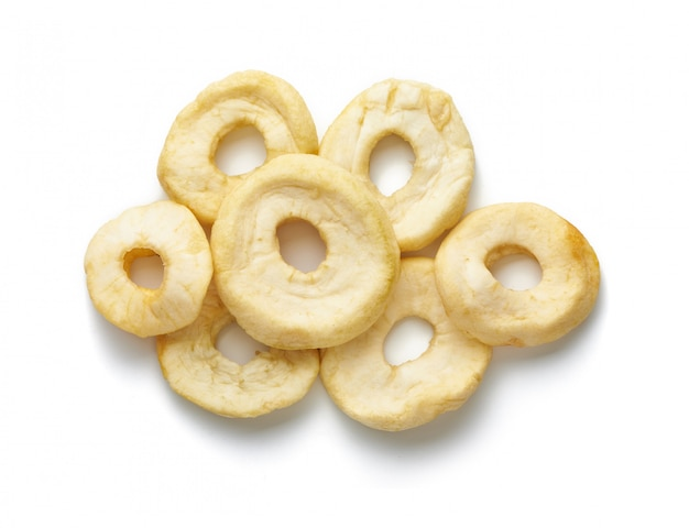 Dried sliced apple rings isolated on white surface. top view.