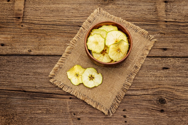 Dried slices of apple in bowl. fruit snack, healthy eating concept