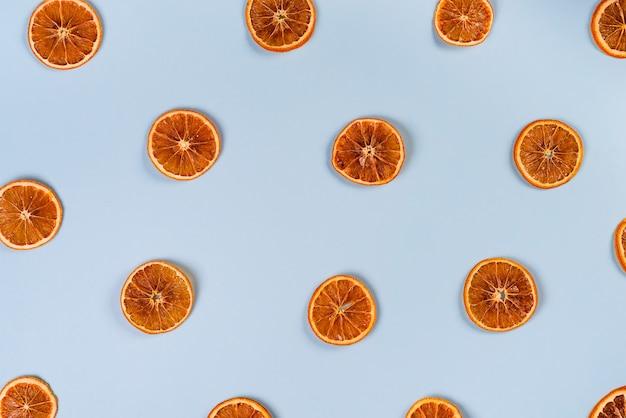Dried slices of orange pattern on blue