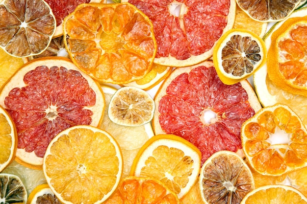 Dried slices of various citrus fruits isolated on white