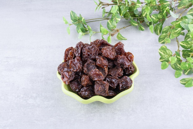 Dried sour cherries in a cup on concrete background. high quality photo