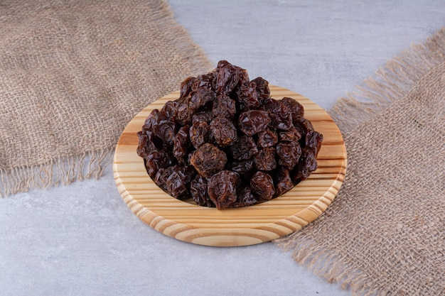Dried sour cherries isolated on concrete background. high quality photo