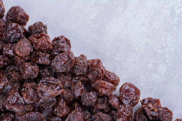 Dried sour cherry plums isolated on concrete surface