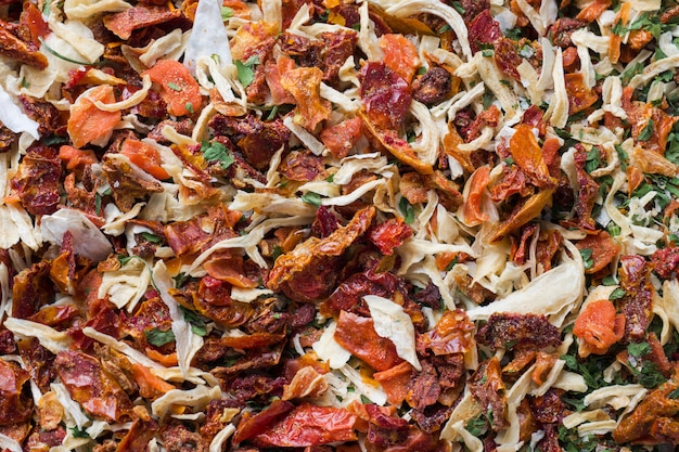 Dried spices, sun-dried tomatoes, dried carrots, basil and provencal herbs.