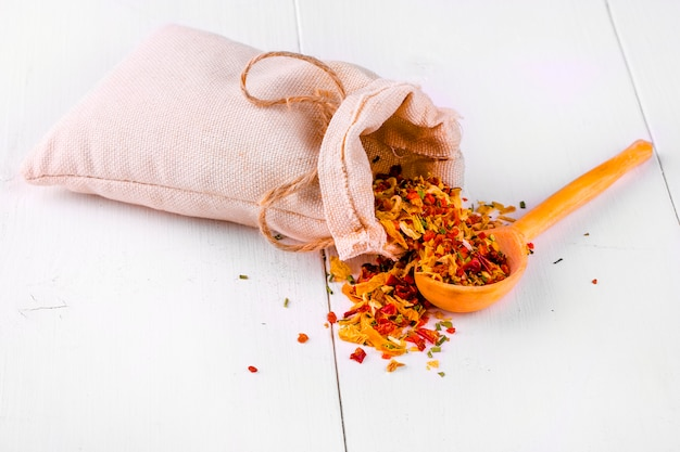 Dried spices  on white wooden surface