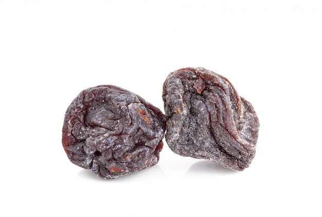 Dried sweet black plums isolated