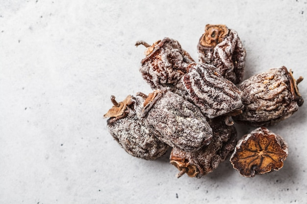 Dried sweet persimmon on a white background, copy space.