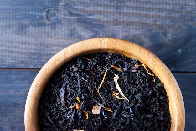 Dried tea leaves in bowl
