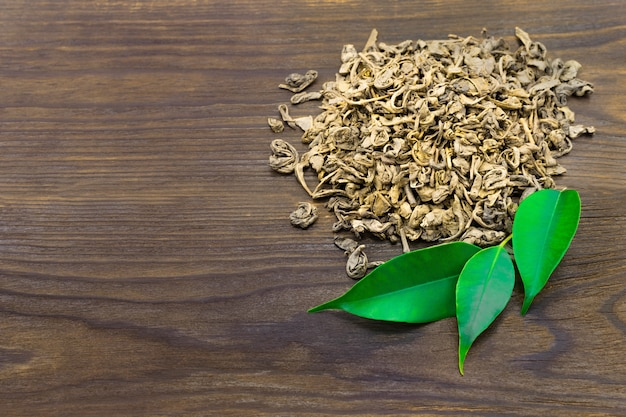 Dried tea with green leaves