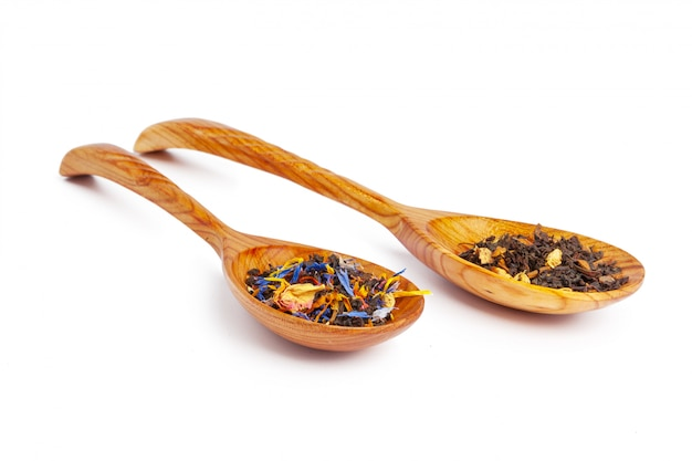 Dried tea on a wooden spoon, isolated