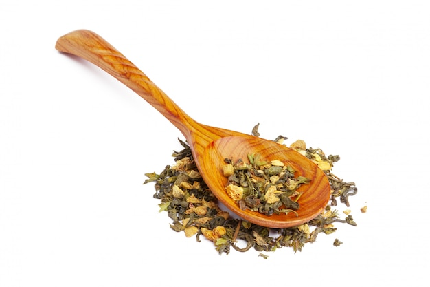 Dried tea on a wooden spoon
