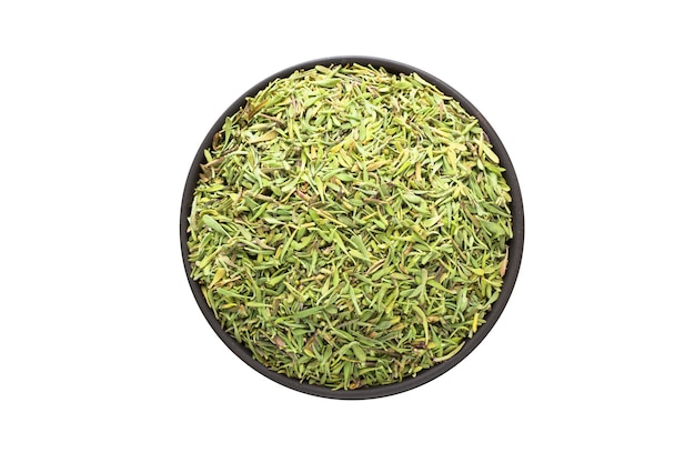 Dried thyme in clay bowl isolated on white background
