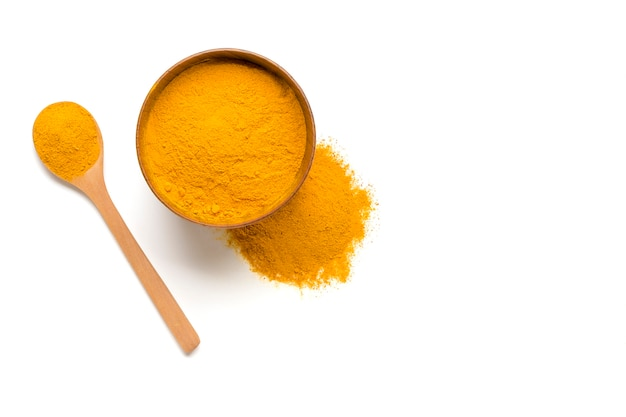 Dried turmeric, (curcumin),  yellow ginger powder isolated on white color background,