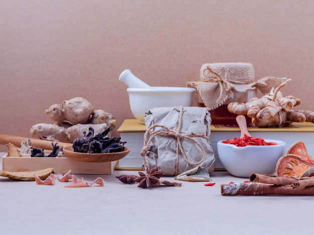 Dried various chinese herbs on old wooden background.