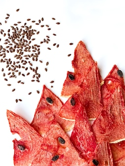 Dried watermelon and melon chips homemade sweet healthy dessert isolated on white.