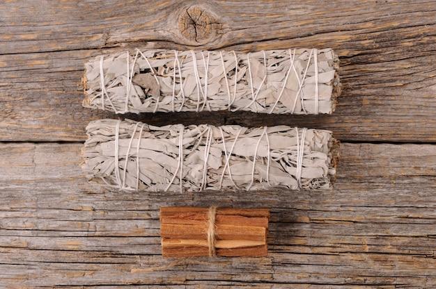 Dried white sage smudge bundles and palo santo sticks